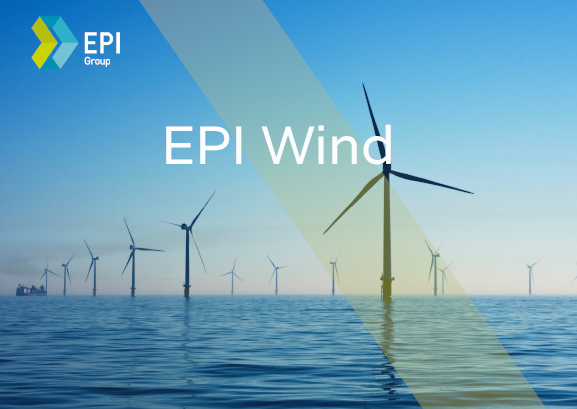 The image shows an offshore wind farm, in a calm blue sea.